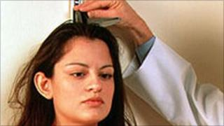 Woman being measured