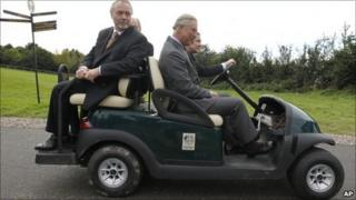 Prince Charles takes a tour of the Ryder Cup venue by golf buggy