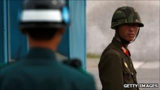 A North Korean soldier (right) looks at South Korean soldier at the border village of Panmunjom (29 September 2010)