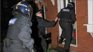 Officers raiding a home in north Manchester