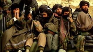 Taliban fighters defecting to the Northern Alliance in 2001
