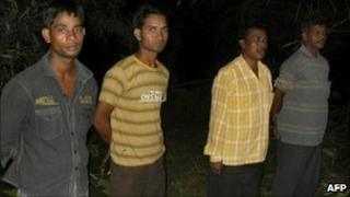 This photograph taken on 29 September 2010 shows four Indian policeman, held hostage by Maoists, on display to journalists in Chhattisgarh state