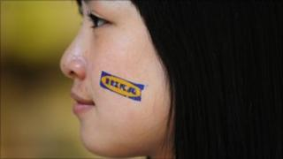 Sales assistant at the opening of Ikea's Nanjing store in China