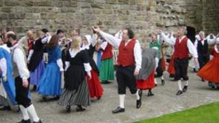 Dawnswyr Caernarfon inside the town's castle