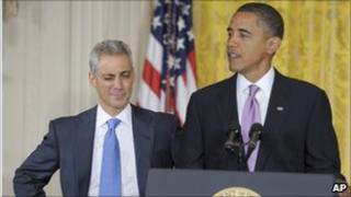 Rahm Emanuel standing next to President Obama