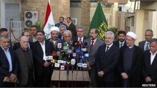 Members of the Iraqi National Alliance speak to the media after a meeting with the State of Law party in Baghdad on 1 October 2010