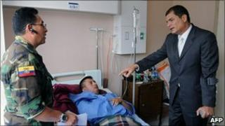 President Correa visits an injured soldier at the Army Hospital in Quito