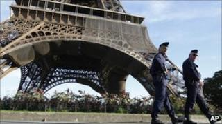French police officers reinforce security at the Eiffel Tower in Paris after reports of new terror threats, 20 September 2010