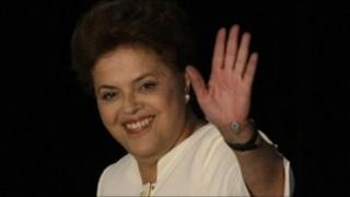 Dilma Rousseff waves to supporters after the election results are announced