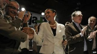 Marina Silva of the Green Party (PV) celebrates her stronger than forecast showing