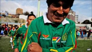 Bolivian President Evo Morales leading his team onto the pitch