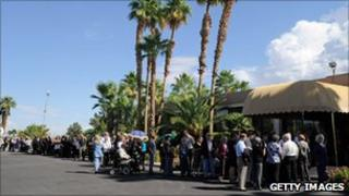 People wait outside the funeral for Tony Curtis