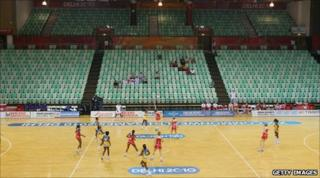 A handful of spectators watch a netball match between England and Barbados at the Thyagaraj Sports Complex during day one of the Delhi 2010 Commonwealth Games on 4 October 2010