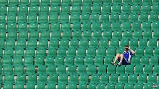 A lone spectator in the stands at a Commonwealth Games hockey match in Delhi