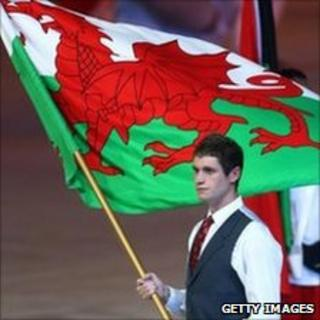 Swimmer David Davies carries the Welsh flag at the Commonwealth Games opening ceremony
