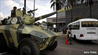 An armoured car stands guard outside the Ecuadorean congress