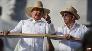 Cuba's President Raul Castro, left, wearing a guayabera shirt, speaking to Vice-President Jose Ramon Machado Ventura, Havana, May 2010