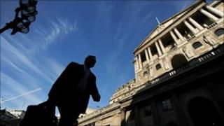 A man walking past the Bank of England