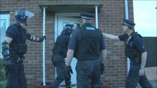 Police officers raid house