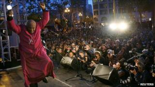 South African Nobel Peace Prize laureate Archbishop Desmond Tutu dancing off the stage in San Francisco
