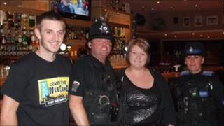 Assistant manager of Club 147 Andrew Edwards-Hughes, PC Gary Donnelly, Sam Bridge, manager of Club 147 and PCSO Gail Starr.