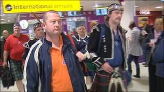 Fans arriving at Edinburgh airport
