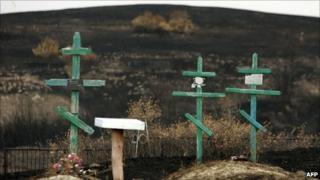 Crosses in a cemetery charred by fire at Russkaya Budnevka, Volgograd region, 5 September