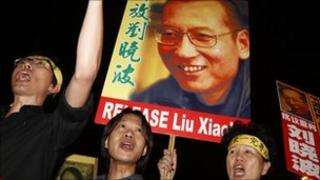 Pro-democracy protesters raise pictures of Liu Xiaobo in Hong Kong, 8 October.