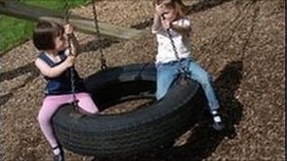 Children on tyre swing
