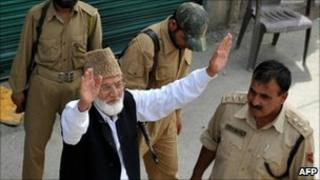 Indian police arrest Syed Ali Shah Geelani (arms raised) in Srinagar on 8 September 2010