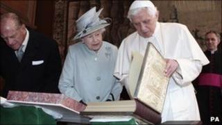 Pope Benedict XVI shows the Queen the copy of the Lorsch Gospels