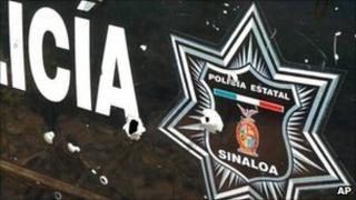 Bullet-riddled side of a police car in Sinaloa