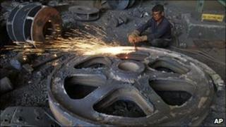 An Indian labourer works in a factory in Dholka