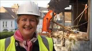 Jenny Tasker in front of St Stephen's Community Centre being demolished