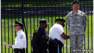 Lt Dan Choi, shown chained to the White House fence
