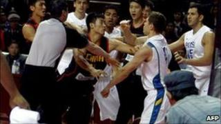 Chinese and Brazilian basketball teams fight in China 12 Oct 2010
