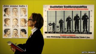Posters of different 'German races' and a Nazi era warning poster on inter racial breeding