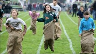 Children take part in the sack race during the Braemar Highland Games