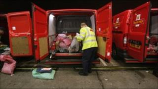 Postman unloading a van at a sorting office in Bristol