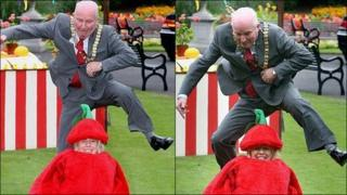 Jim Rodgers attempting to jump over Lorraine Mallon