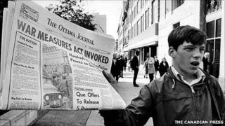A newspaper with a banner headline reporting the invoking of the War Measures Act, in Ottawa, 16 Oct 1970 (Image copyright Canadian Press)