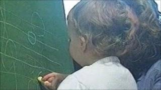 Toddler at blackboard