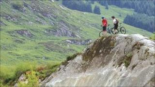 Picture of couple biking in the mountains