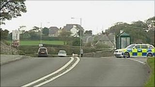 A police patrol car near the scene of Saturday's crash