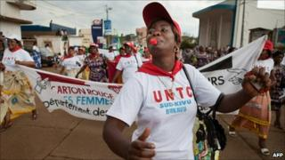 "A Congolese woman blows a whistle during the ""World March of Women"" in Bukavu (17 October 2010)"