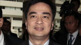Thai Prime Minister Abhisit Vejjajiva arrives at the Constitution Court in Bangkok