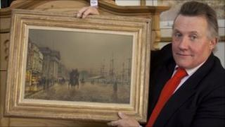 Auctioneer Jim Railton with the painting