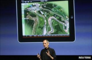 Apple chief executive Steve Jobs presenting in front of a blow-up image of an iPad