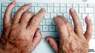 Elderly patient using a keyboard