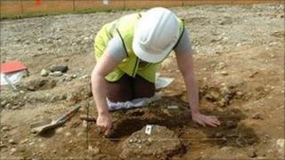 An archaeologist excavating a Bronze Age crematorium